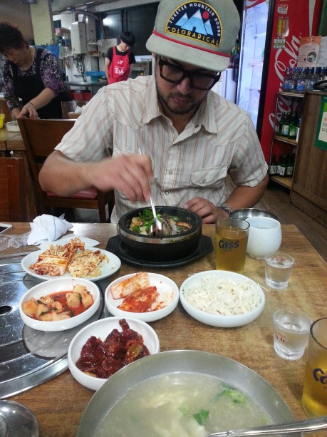 David's first time enjoying bibimbap, which was of course accompanied by an array of side dishes (banchan), as well as beer (maekju) and soju.