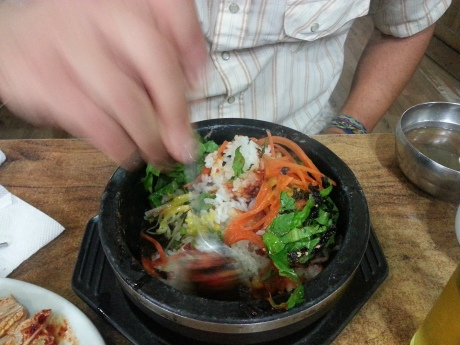 Before eating bibimbap you must thoroughly mix everything together.