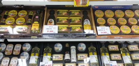 Gift baskets take over grocery stores and markets this time of year.  Who wouldn't want a Spam gift set?