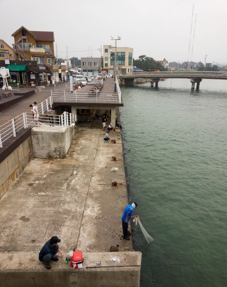 Fisherman on one of the piers in Gyeongpo.
