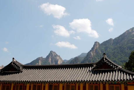 Korean rooftops and craggy peaks.