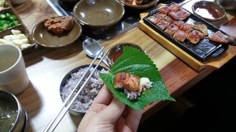 Grilled eel which I ate wrapped in a perilla leaf with rice and garlic. So good.