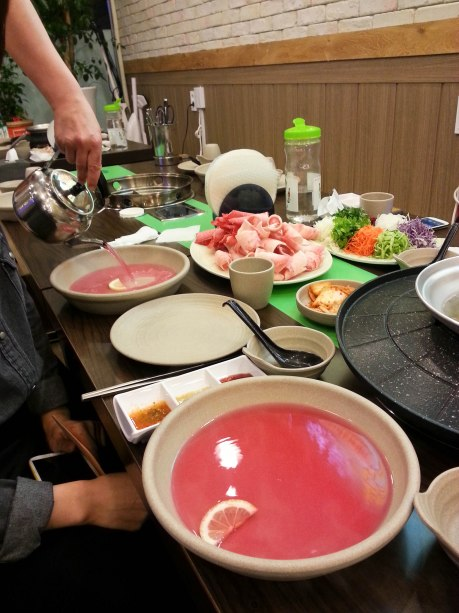The pink water is for softening the rice paper. I have yet to find out what they put in the water to make it pink.