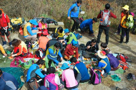 Hikers feasting in Songnisan National Park.