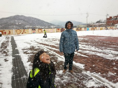Happy students playing in the snow.