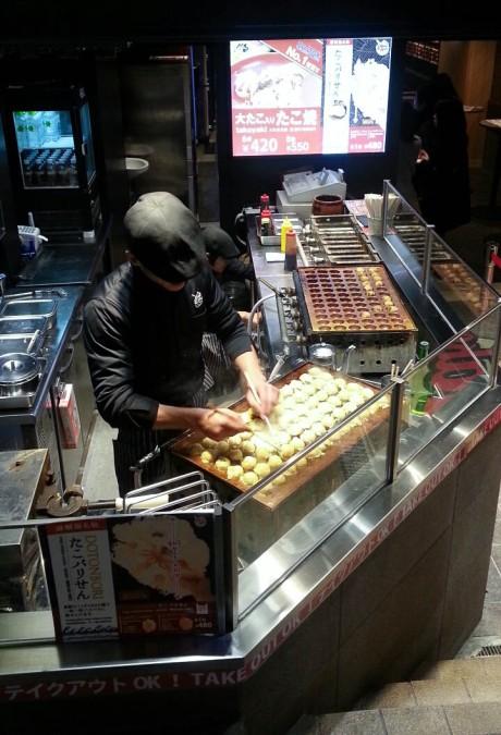 Making takoyaki.