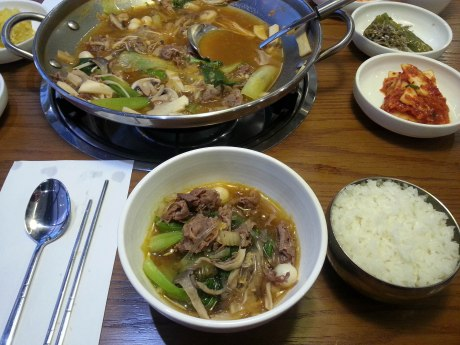 This is bulgogi jungol (a stew of sorts) that has extra broth, glass noodles and rice cake in addition to the beef, mushrooms, onions and bok choy. At this particular restaurant they used fruit juices to sweeten the marinade instead of sugar, making it one of my favorite bulogi dishes so far.