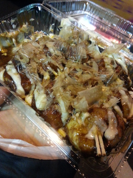 Takoyaki, a flour based pancake-like ball filled with octopus. Little stands selling them at all hours are all over Osaka.